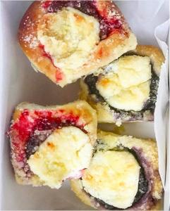 Box of strawberry and blueberry cream cheese kolaches